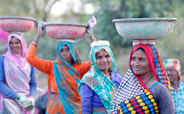 Indian women working hard in  road-building in Khajuraho, India stock photo