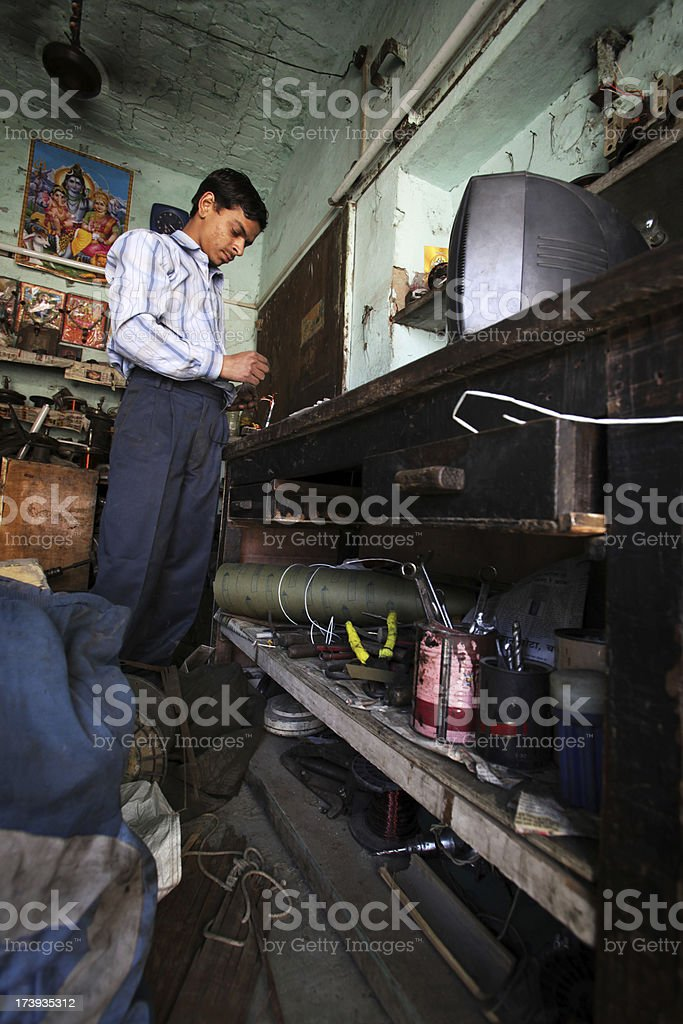 Indian workers: electrical work stock photo