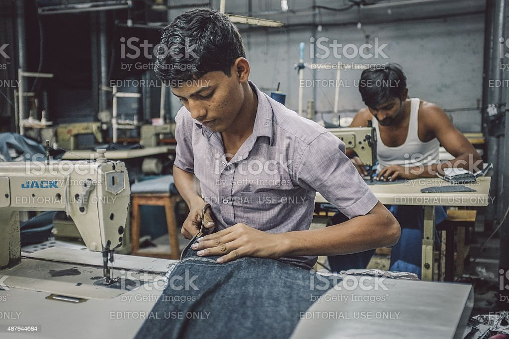 Indian workers sewing stock photo