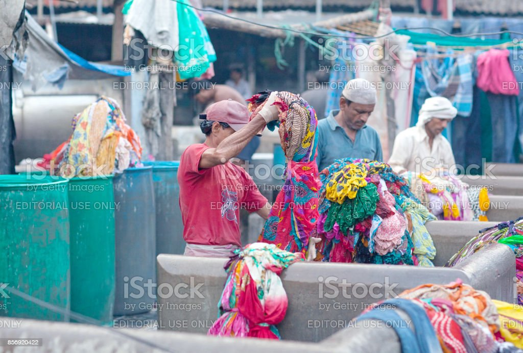 Indian workers washing clothes at Dhobi Ghat in Mumbai, India stock photo