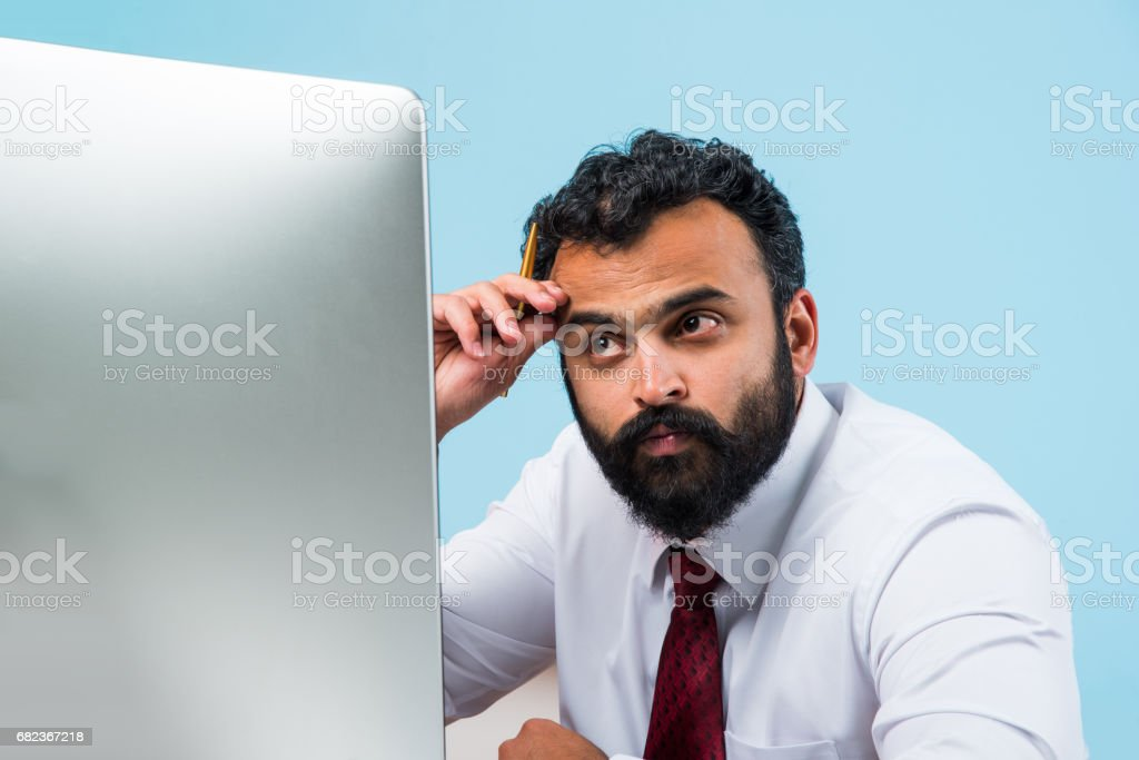 indian young and trendy looking or hipster businessman in office wear in beard having headache or frustrated or sad zbiór zdjęć royalty-free