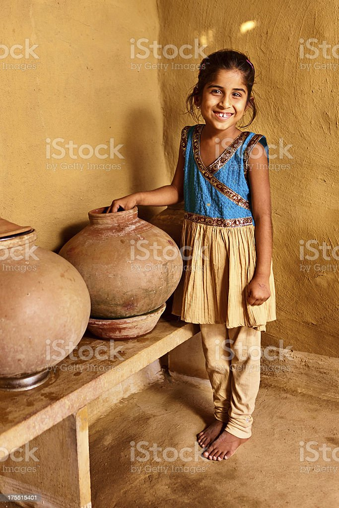 Indian young girl drinking water stock photo