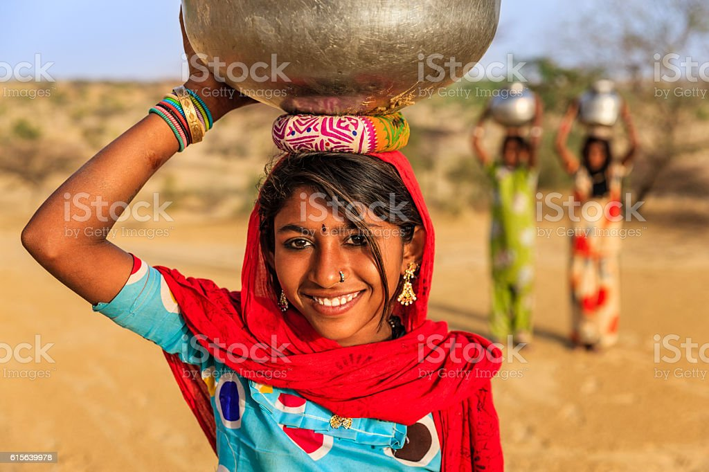 Indian Young Girls Carrying On Their Heads Water From Well Stock ...