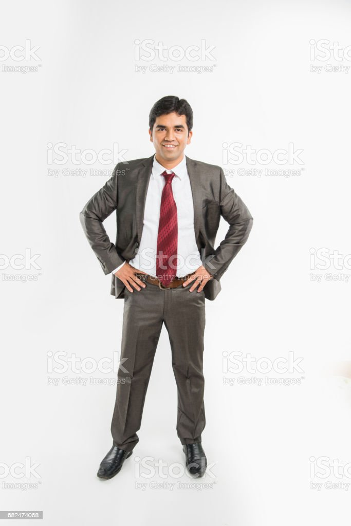 indian young & handsome businessman in clean shave and office wear standing, looking up / in the sky, a view from top also known as bird's eye view showing perspective, isolated over white background royalty-free stock photo