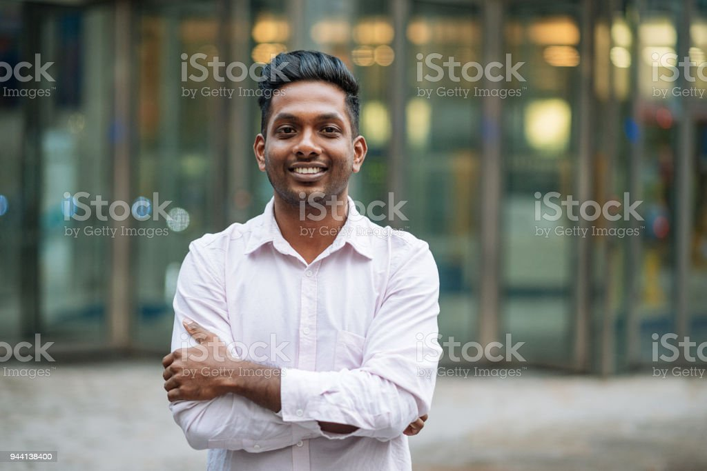 Indian young man in London, expressing positive emotion stock photo