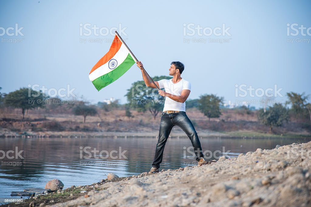 indian young man waving indian flag - foto de stock