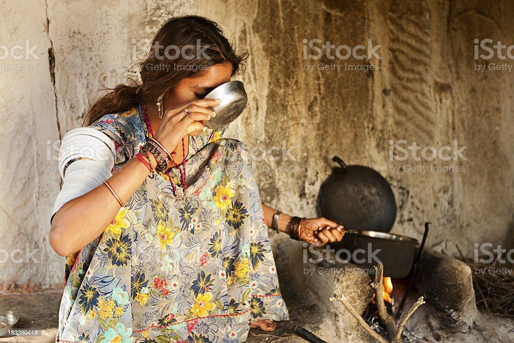 Indian young woman drinking tea. Bishnoi village. Rajasthan. Thar desert. royalty-free stock photo