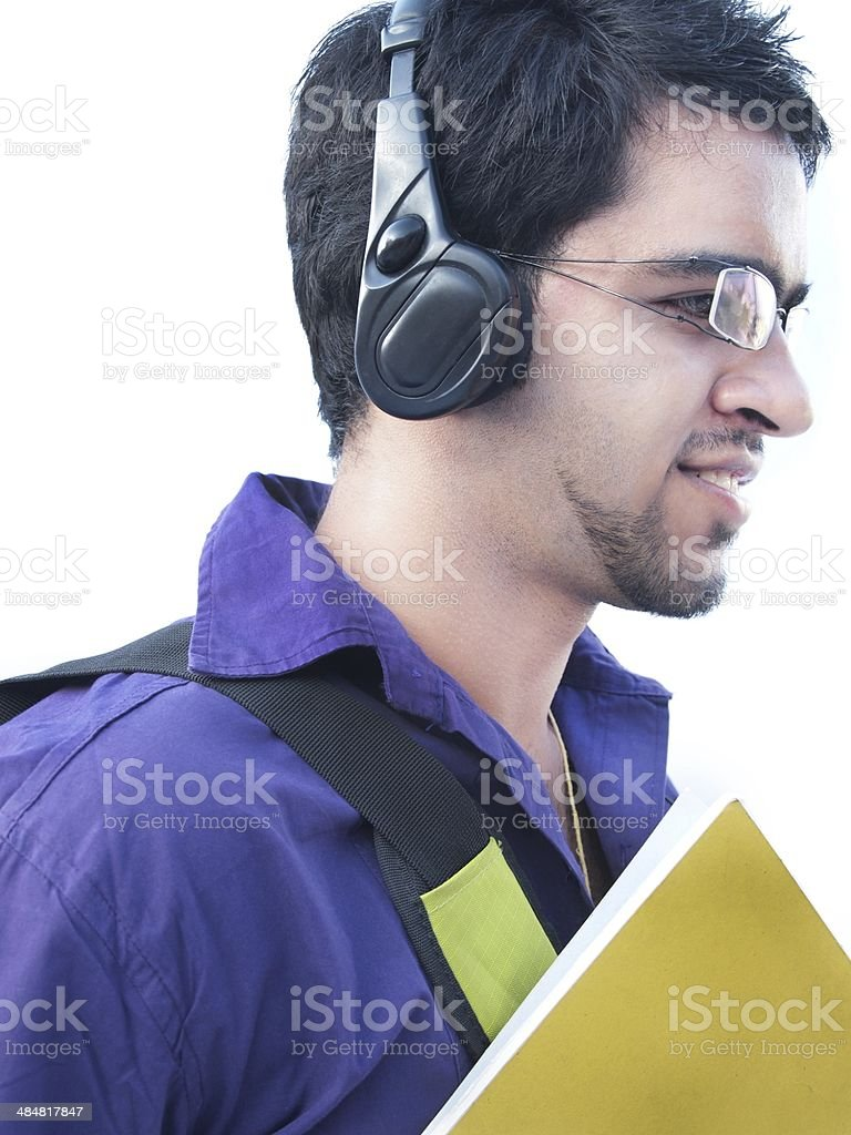 Indian Youth Going To College And Listening Music Stock Photo