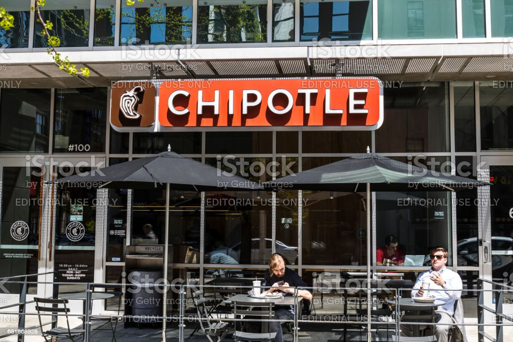 Indianapolis - Circa April 2017: Chipotle Mexican Grill Restaurant. Chipotle is a Chain of Burrito Fast-Food Restaurants XIII stock photo