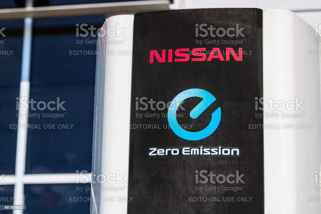 Indianapolis - Circa April 2017: Electric Vehicle Quick Charger at a local Nissan Car Dealership. The Nissan LEAF EV is a best-selling vehicle III stock photo