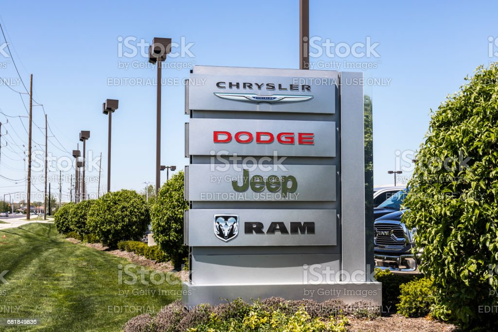 Indianapolis - Circa April 2017: Logo and Dealership Signage of the four American Subsidiaries of FCA - Chrysler, Dodge, Jeep and Ram Trucks VI stock photo