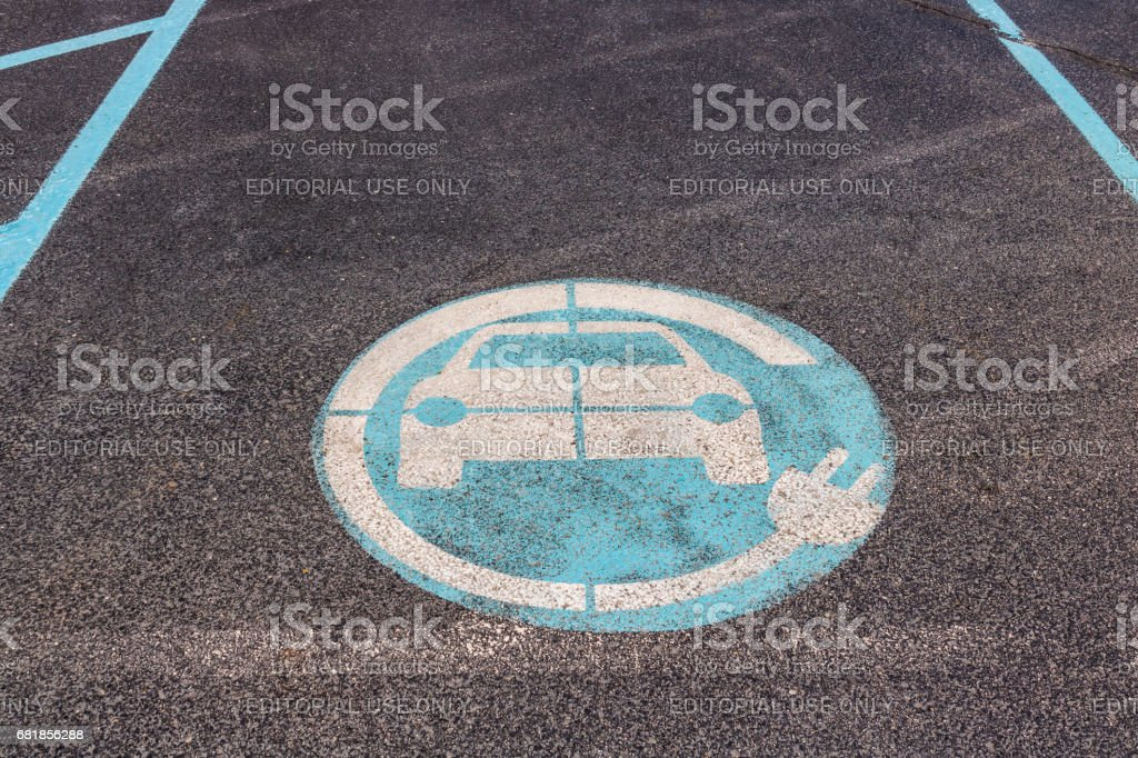 Indianapolis - Circa April 2017: Parking Spot reserved for EV or Electric Vehicle at a Nissan Dealership. The Nissan LEAF EV is a best-selling vehicle IV stock photo