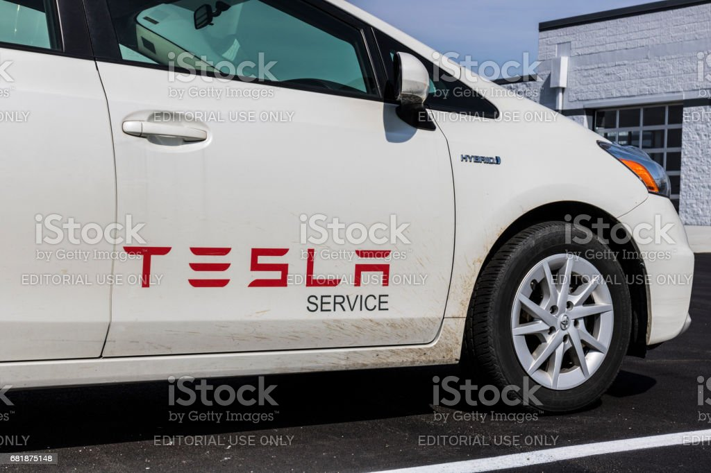 Indianapolis - Circa April 2017: Tesla Service Vehicle. Ironically, Tesla uses a Toyota Prius Hybrid Vehicle for a service car V stock photo