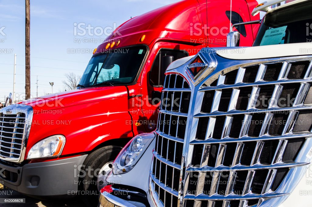 Indianapolis - Circa February 2017: Navistar International ane Freightliner Semi Tractor Trailer Trucks Lined up for Sale. Big Rig trucks transport goods Americans use every day III stock photo