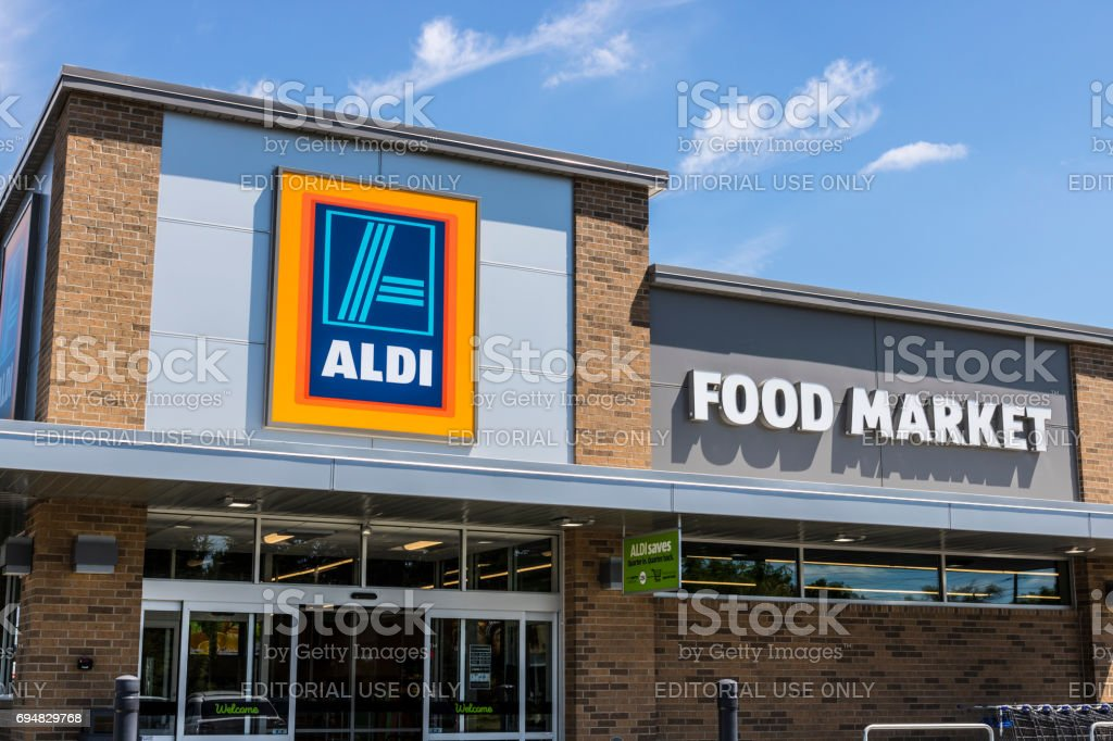 Indianapolis - Circa June 2017: Aldi Discount Supermarket. Aldi sells a range of grocery items, including produce, meat & dairy, at discount prices IX stock photo