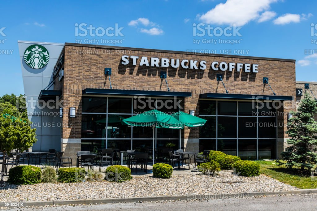 Indianapolis - Circa June 2017: Starbucks Retail Coffee Store. Starbucks Inclusion Academy prepares people with disabilities for retail jobs XIII stock photo