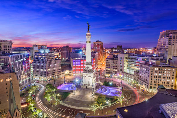 Indianapolis, Indiana, USA Indianapolis, Indiana, USA skyline over Monument Circle. monument stock pictures, royalty-free photos & images