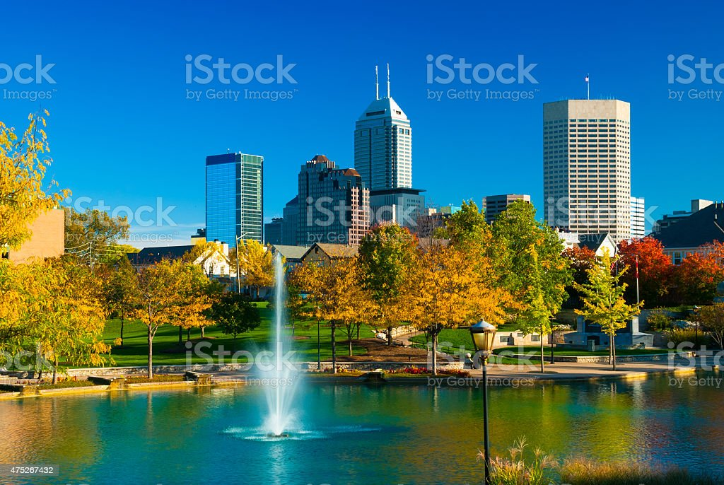 Indianapolis skyline with a fountain and park during Autumn stock photo
