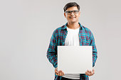 Indian/Asian Young Man showing blank signboard on White background