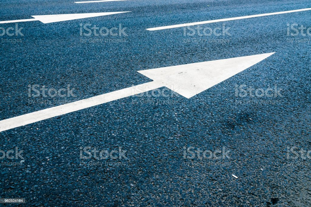 Indicative arrows on an asphalt road close up - Royalty-free Abstract Stock Photo