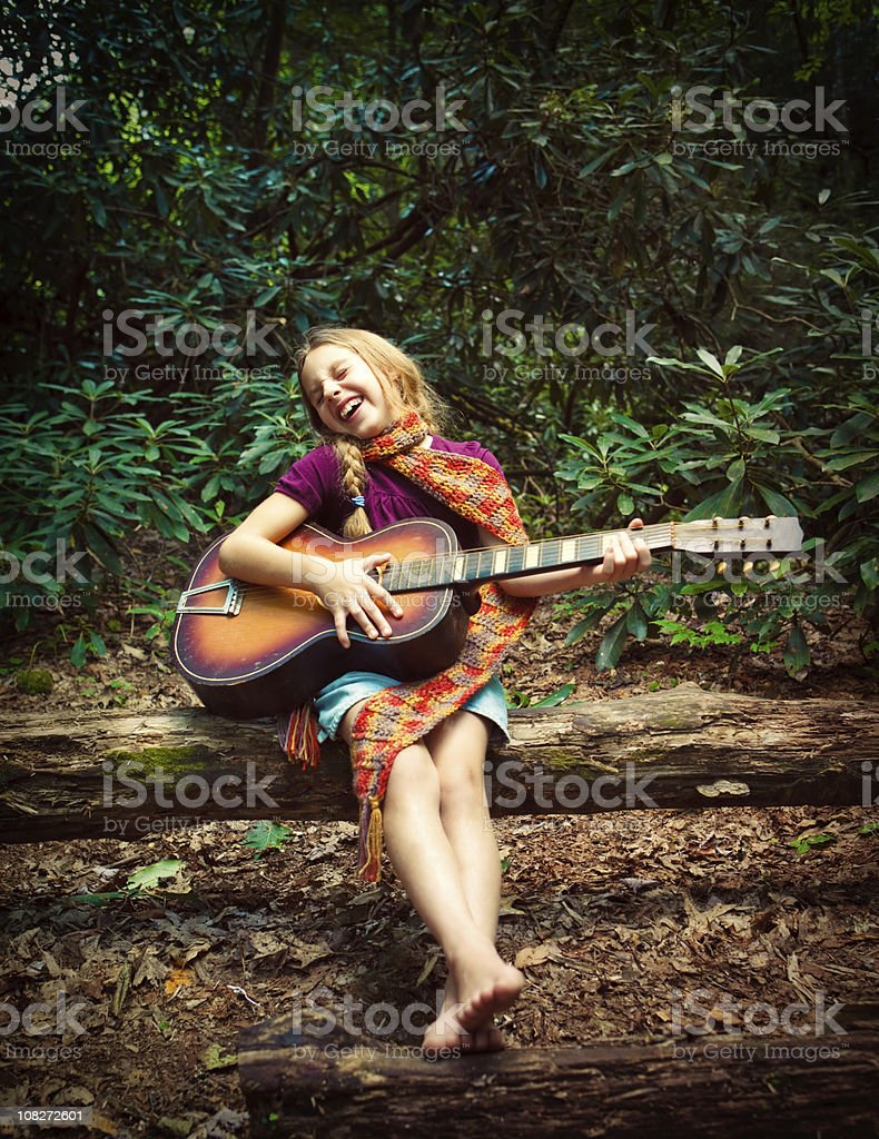 indie girl playing the guitar stock photo