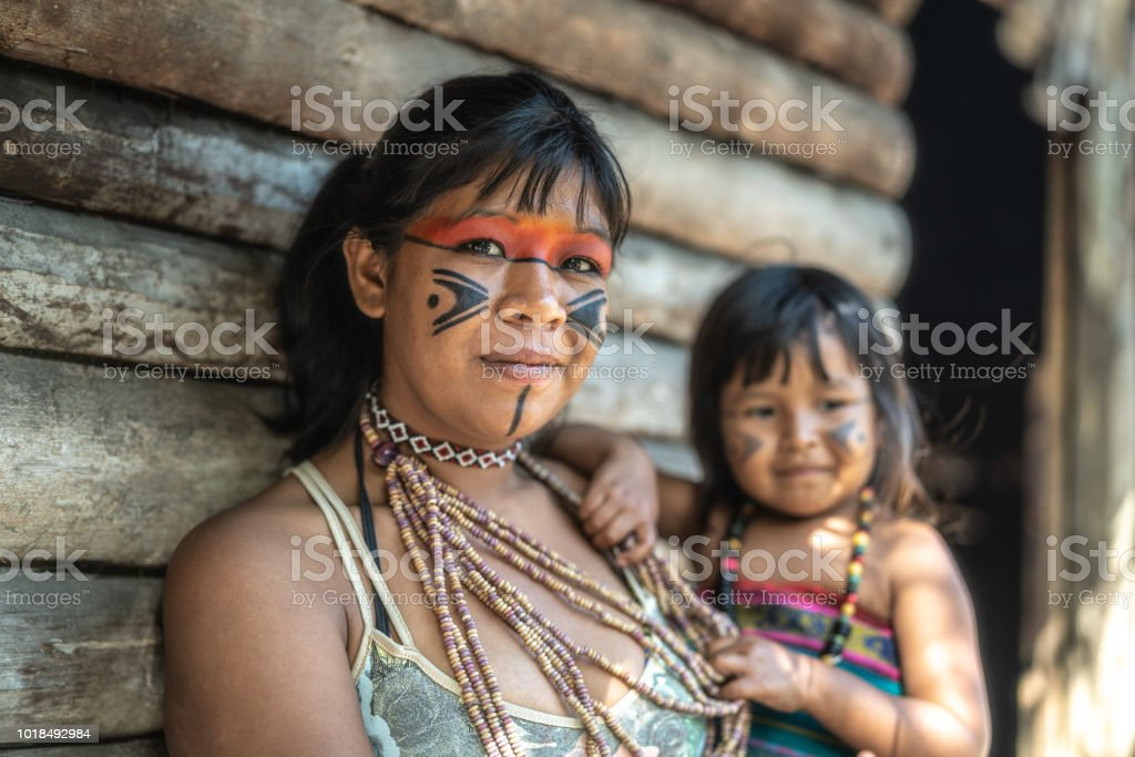 Indigenous Brazilian Young Woman and Her Child, Portrait from Tupi Guarani Ethnicity stock photo