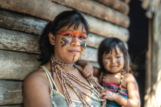 Indigenous Brazilian Young Woman and Her Child, Portrait from Tupi Guarani Ethnicity Beautiful shooting of how Brazilian Natives lives in Brazil brazilian culture stock pictures, royalty-free photos & images