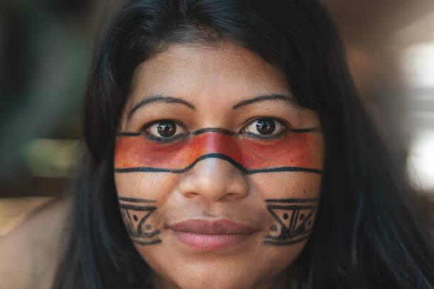 Indigenous Brazilian Young Woman Portrait, from Guarani Ethnicity, in a Hut - Closeup stock photo