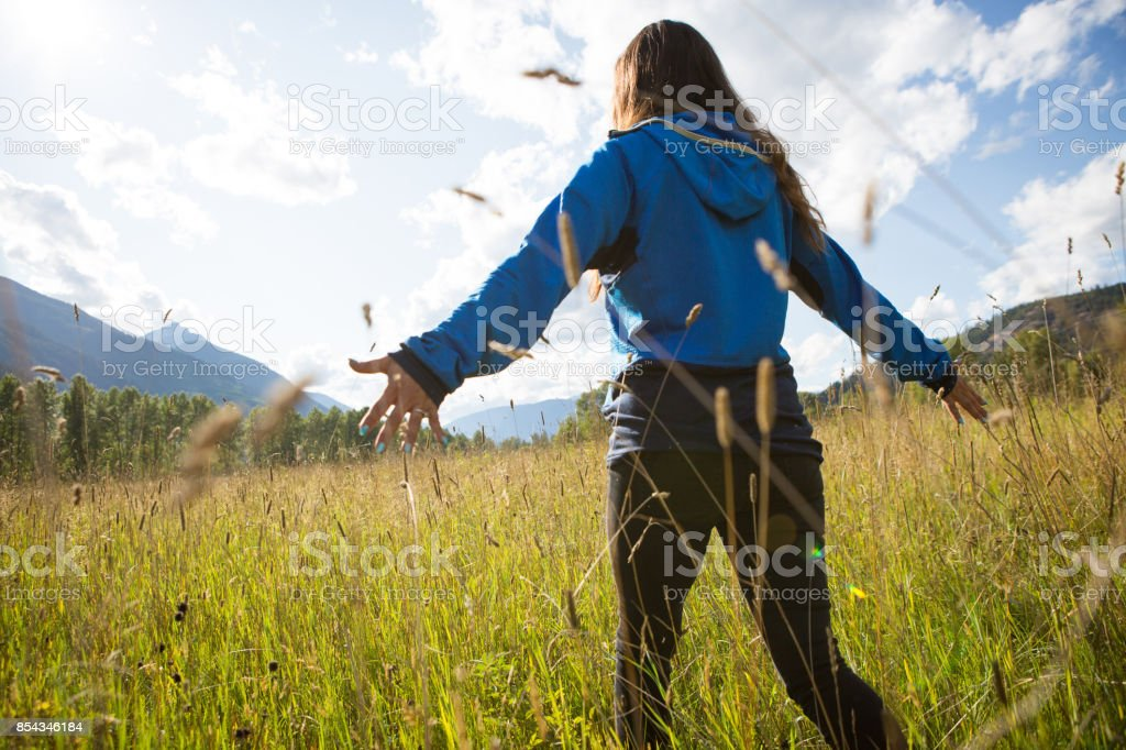 Indigenous Canadian walking in the field stock photo
