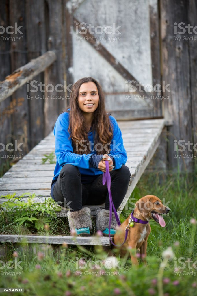 Indigenous Canadian woman with her brown dog stock photo