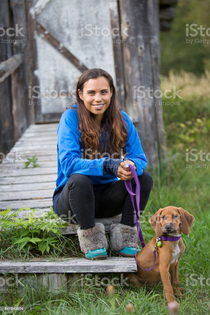 Indigenous Canadian woman with her pet dog stock photo