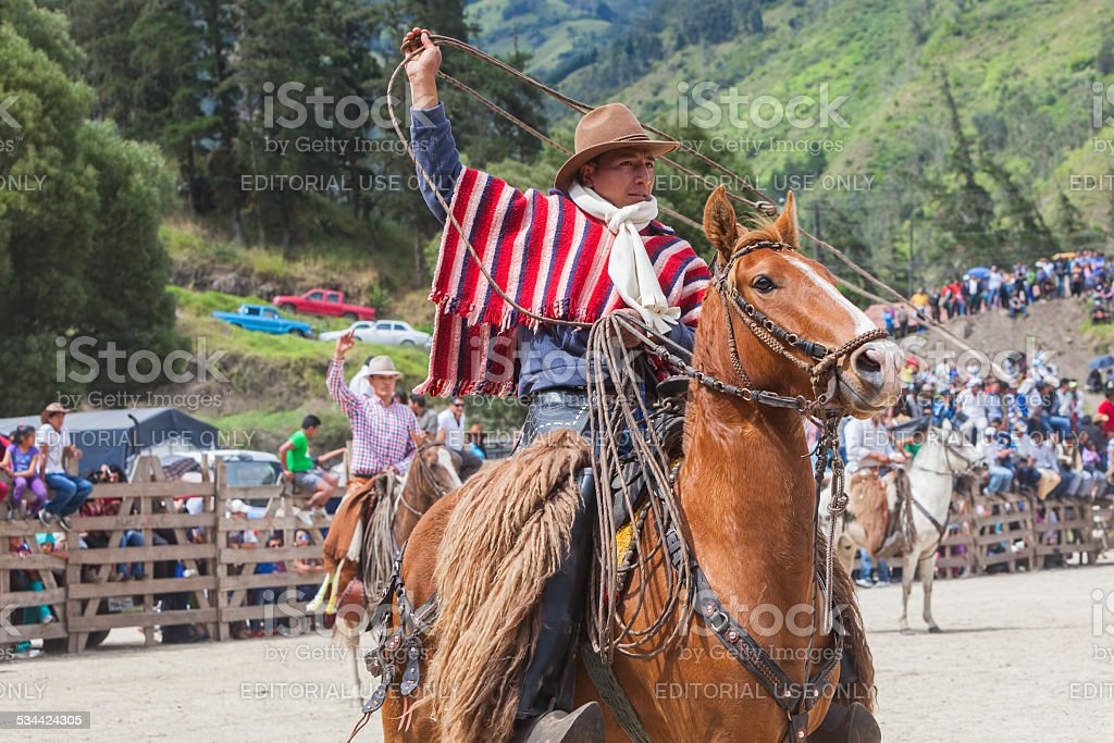 Indigenous Cowboy Riding Horse stock photo