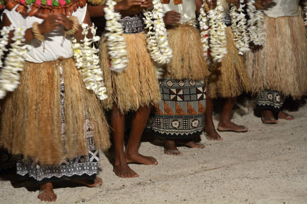 Indigenous Fijian people sing and dance in Fiji stock photo