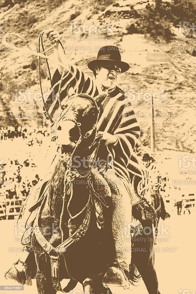 Indigenous Man Riding A Horse And Holding A Lasso stock photo