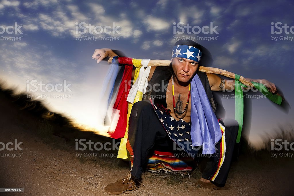 Indigenous man with ceremonial pole stock photo
