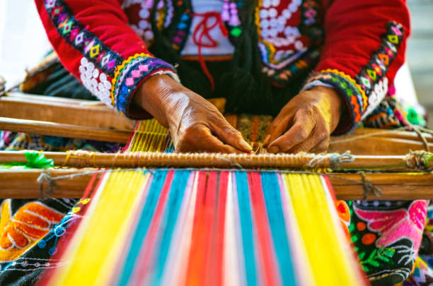Indigenous Textile Weaving, Cusco, Peru Peruvian indigenous Quechua woman weaving a textile with the traditional techniques in Cusco, Peru. tradition stock pictures, royalty-free photos & images