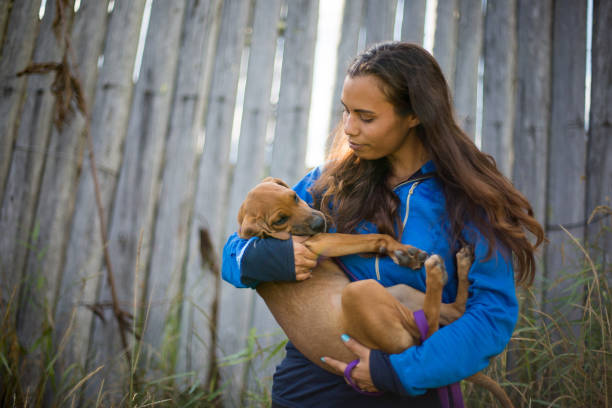 Indigenous woman plays with her dog stock photo