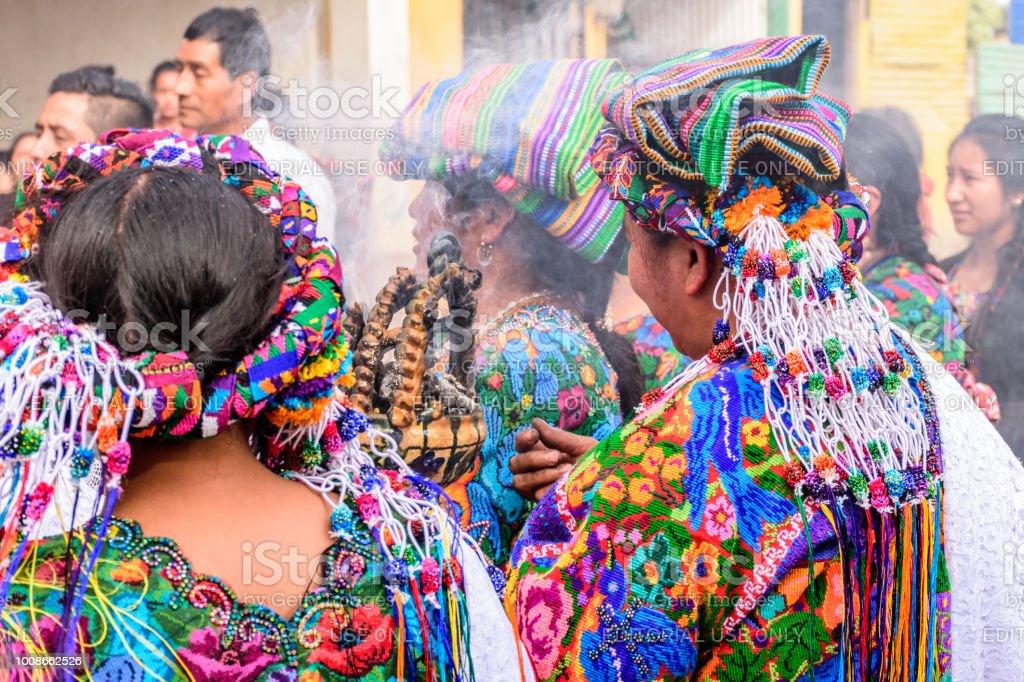 Local indigenous Maya women dressed in ceremonial headdresses &...