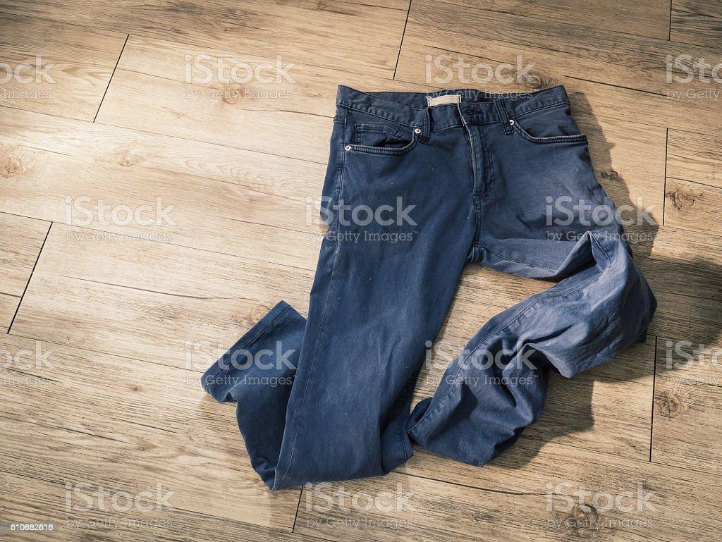 indigo navy blue pants on wooden background stock photo