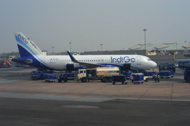Indigo passenger plane at the Delhi International airport in India. Delhi-India March-4-2018 indigo passenger plane at the Delhi International airport in India. air transport building stock pictures, royalty-free photos & images