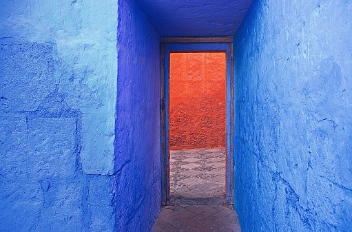 Indigo and orange walls in the famous Santa Catalina monastery, Arequipa, Peru