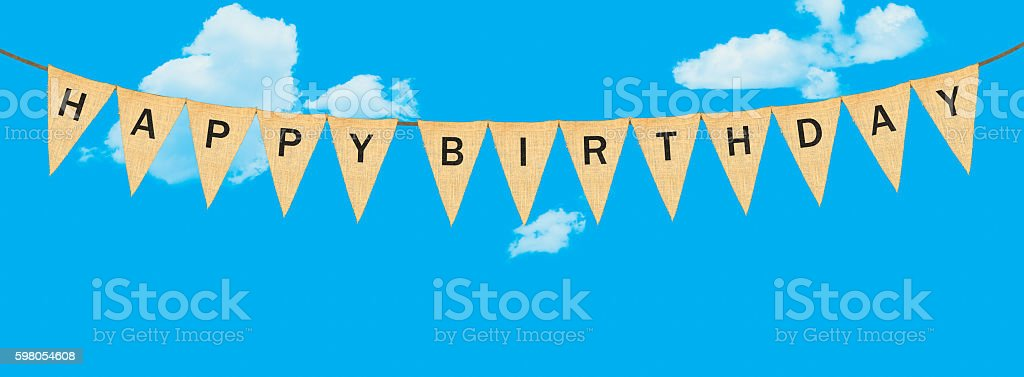 Individual cloth pennants or flags with Happy Birthday stock photo