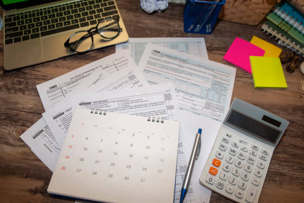 Individual Income Tax Planning Budget Concept.Calendar 2019 and Individual Income Tax Form For who have income According to United States law.This is the season that has to pay taxes,deadline of tax payment. taxes stock pictures, royalty-free photos & images