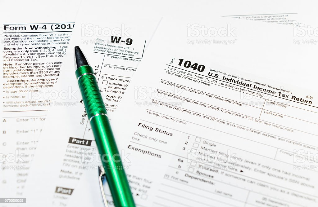 1040w9 Individual Income Tax Return Form With A Pen Stock Photo