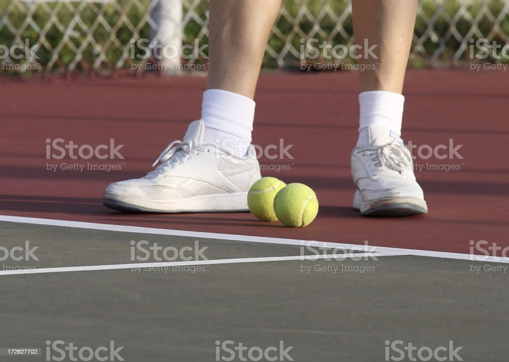 Individual preparing for a tennis match royalty-free stock photo