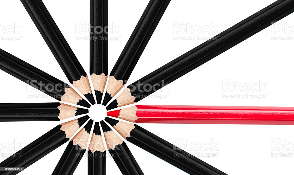 Individual red colored pencil with black pencils stock photo