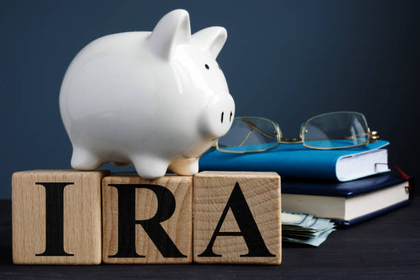 IRA individual retirement account written on wooden cubes. stock photo