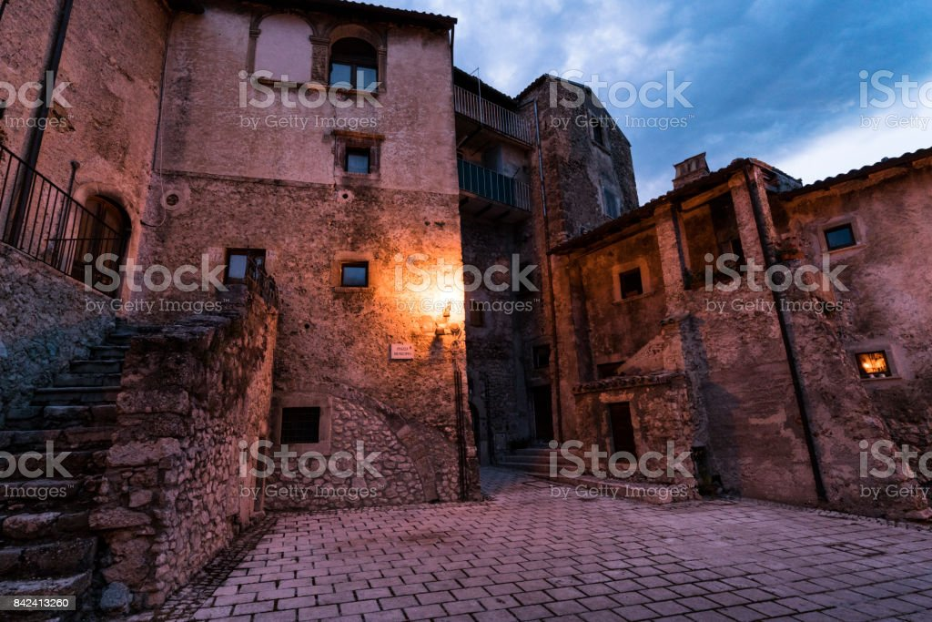Individual rooms and homes among the ancient architecture in this tiny village has been turned into a diffused hotel, Santo Stefano di Sextantio, in the medieval fortified village of Santo Stefano di Sessanio at night; Gran Sasso National Park; L'Aquila P stock photo