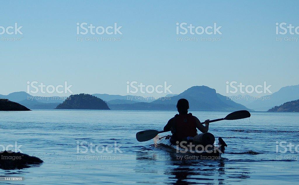 Individual silhouette on a kayak stock photo