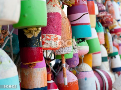 Worn painted marker buoys hanging